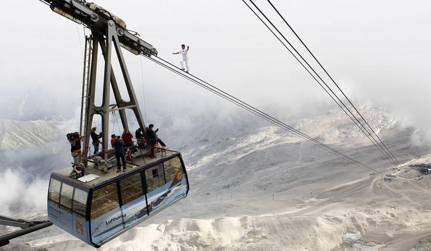 Stuntman climbs ski lift cable lines